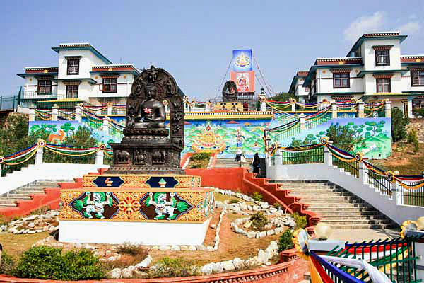Druk Amitabha Mountain Nunnery in Nepal with its beautiful staircase of Buddha statues. This is the first place we'll be visiting on our trip.