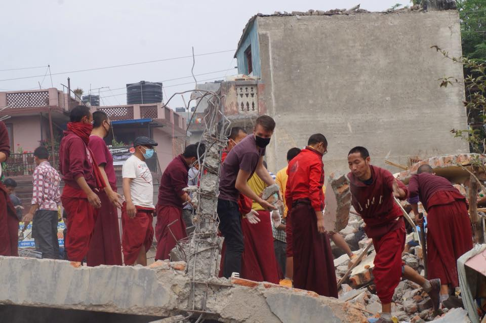 Monks and volunteers assisting with the rescue efforts after the earthquake in Nepal
